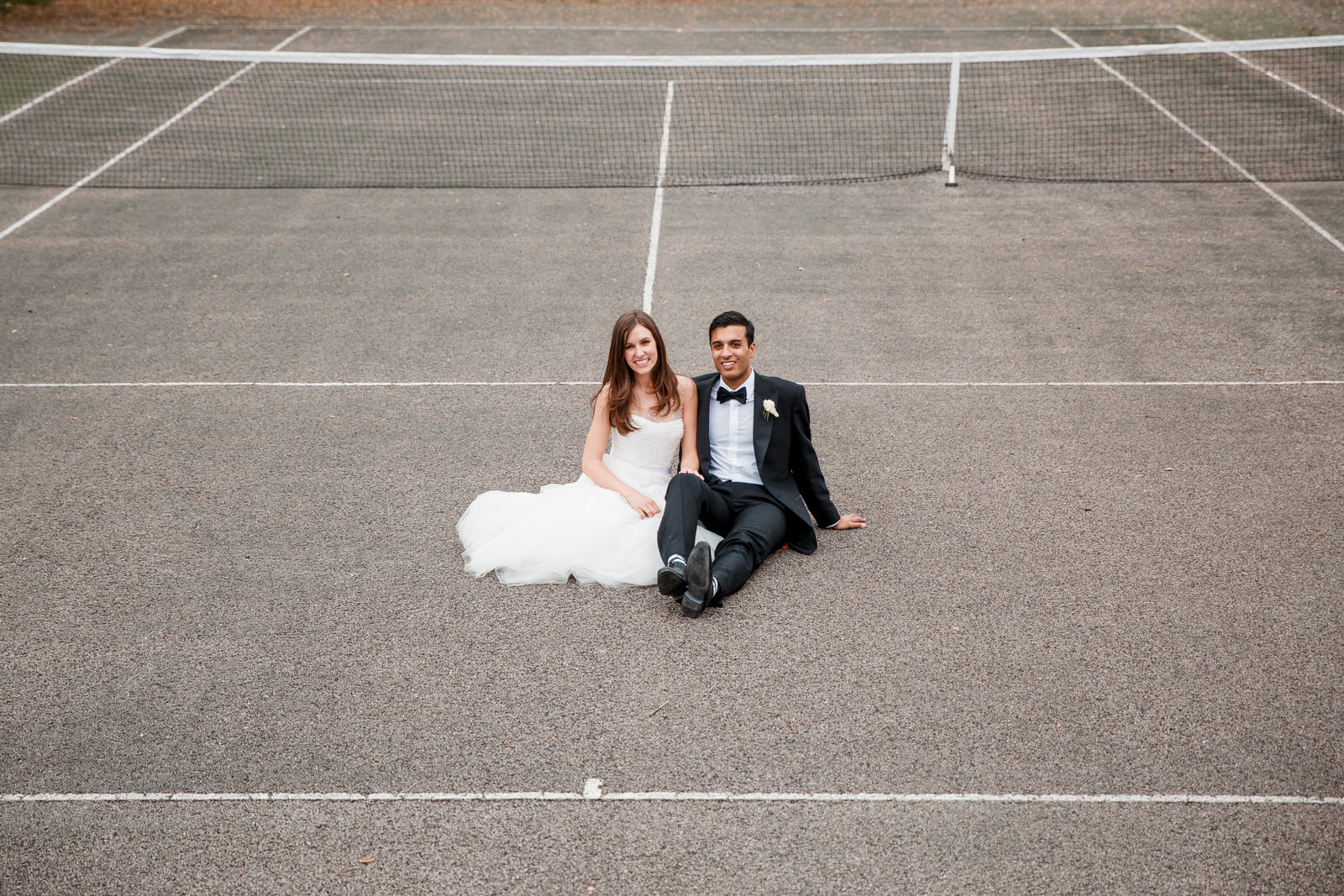 bride and groom on tennis courts at middle stanley wedding venue