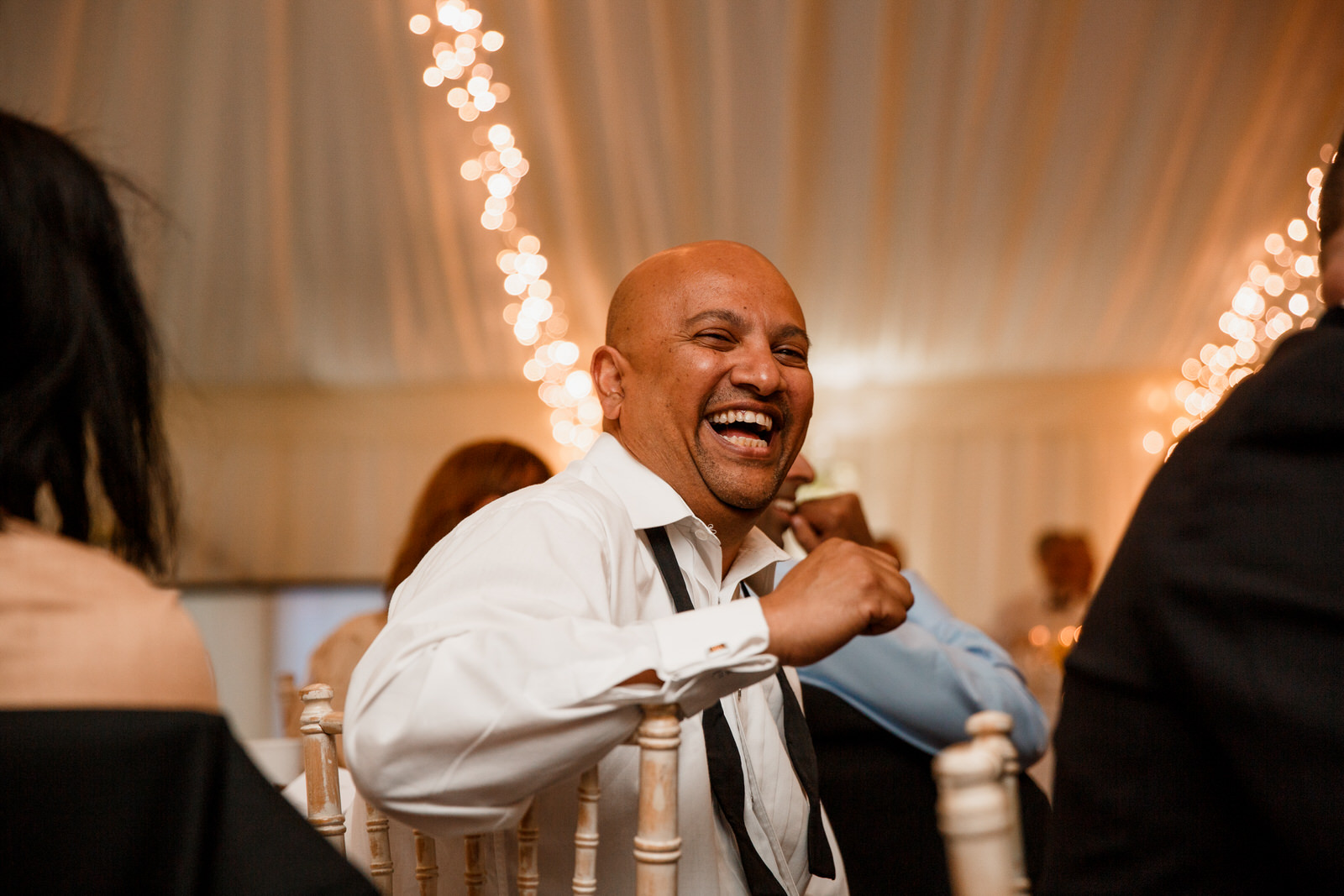 middle stanley wedding guest laughing