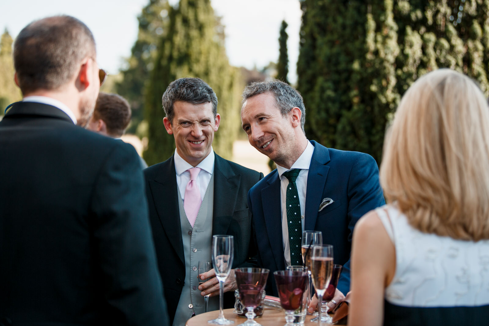 lauging guests at hedsor house wedding