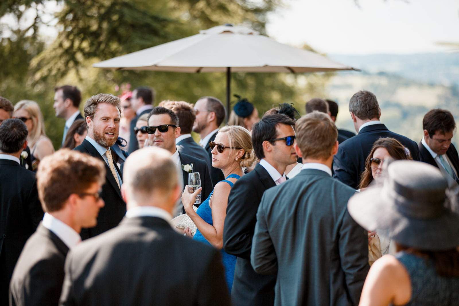 guests in garden of hedsor house for a wedding