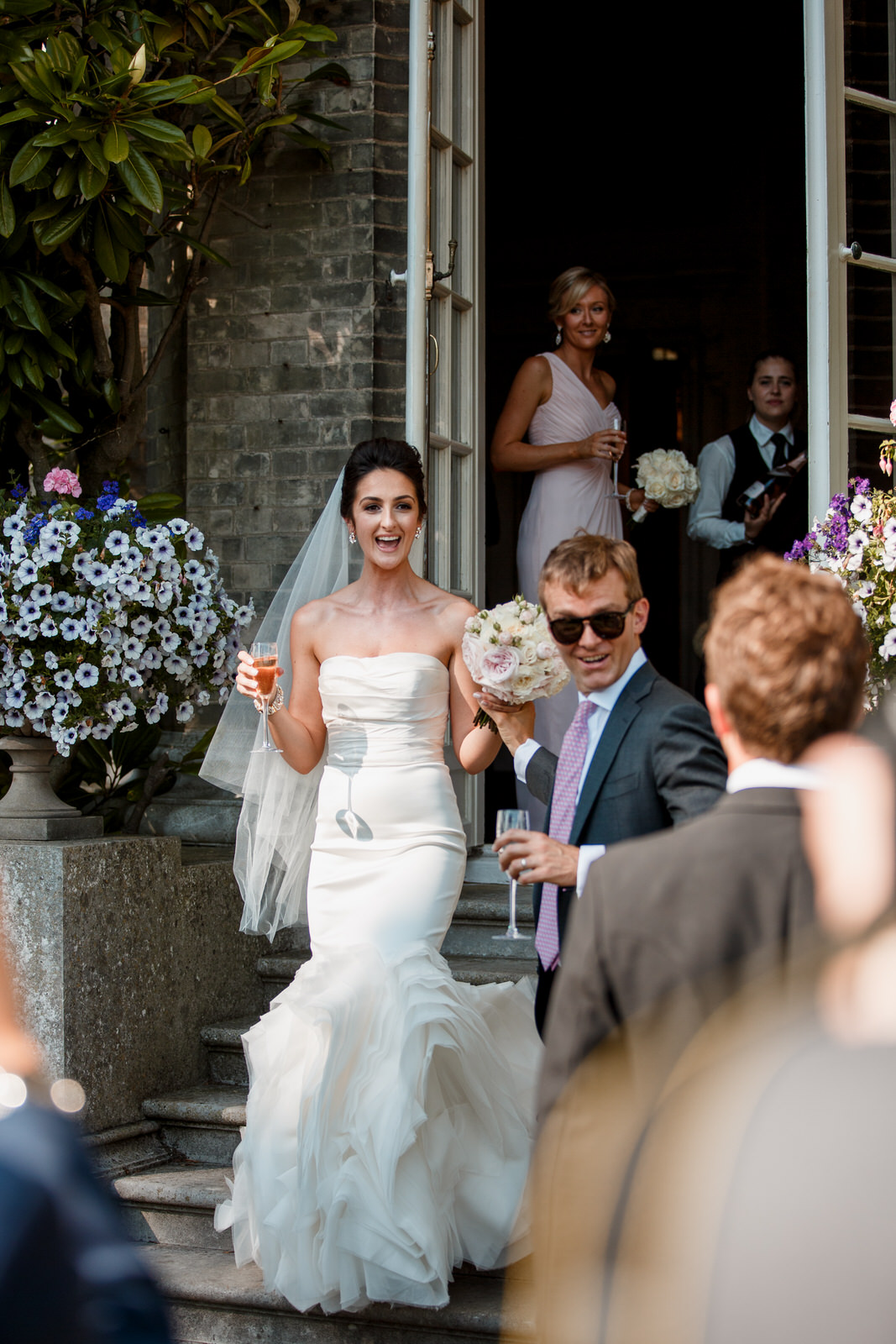 bride coming out of double doors at hedsor house