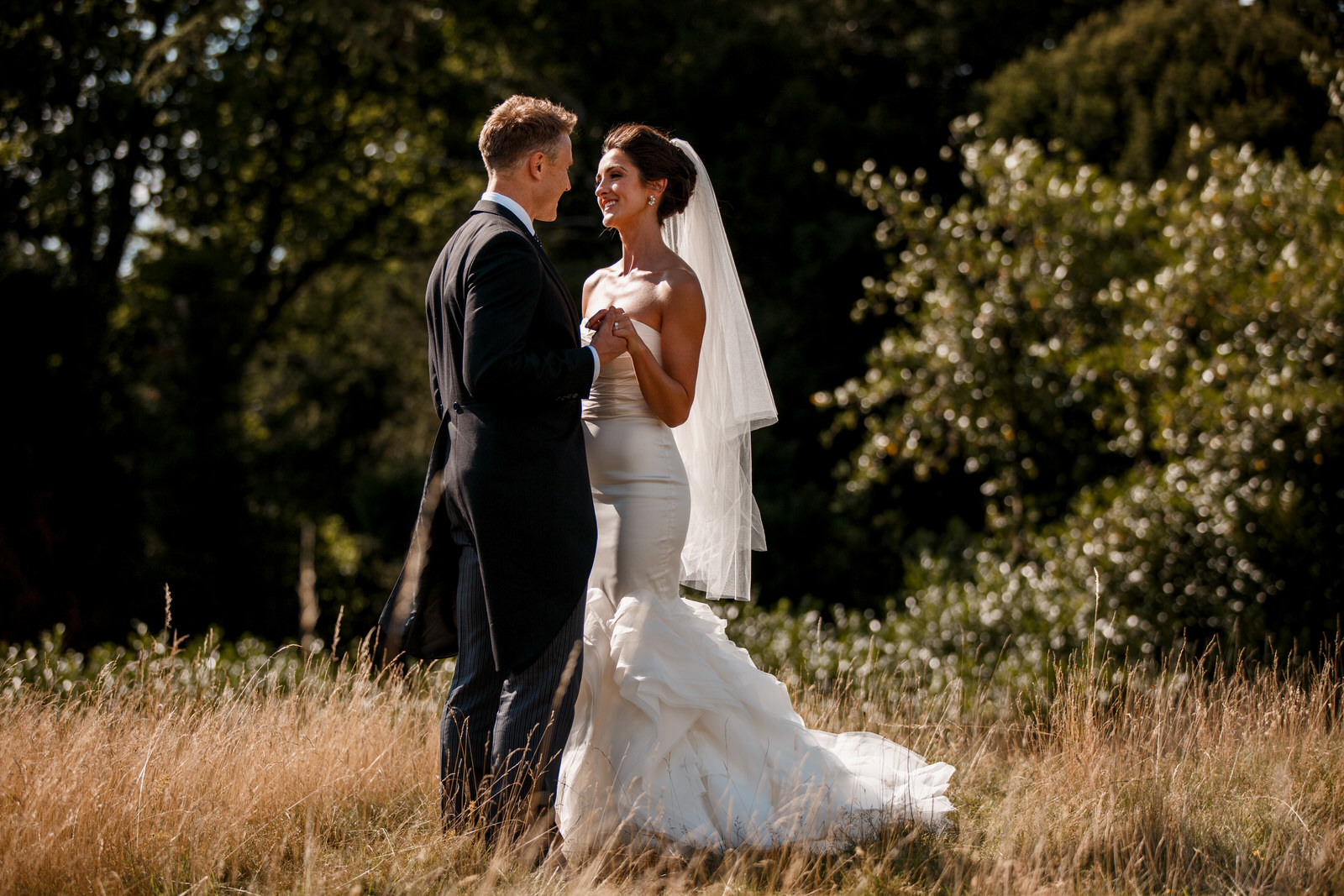 bride and groom outside hedsor house for their wedding photography