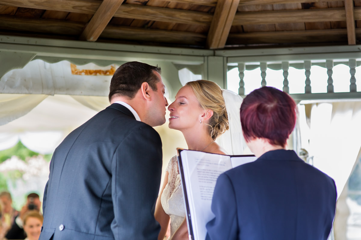 first kiss at wedding outside chapel down winery