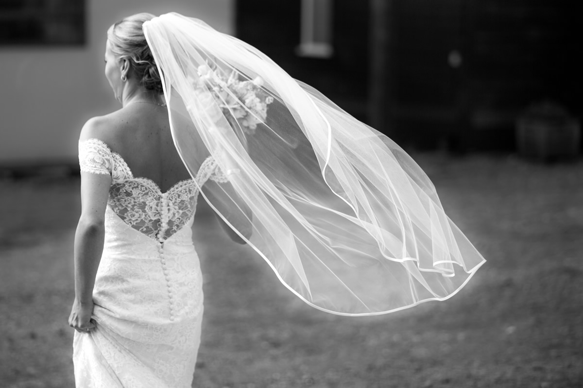 bride walking in wedding dress at chapel down winery