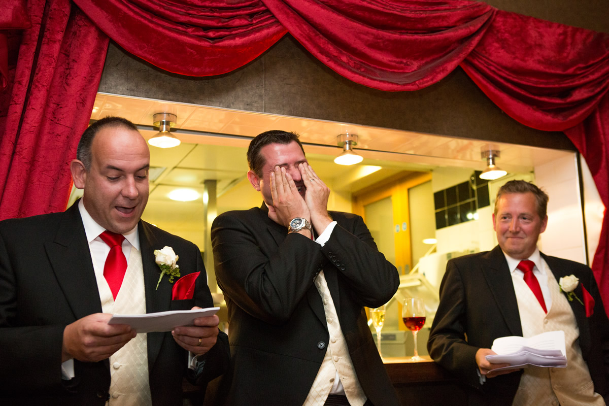 embarrassed groom at wedding speech