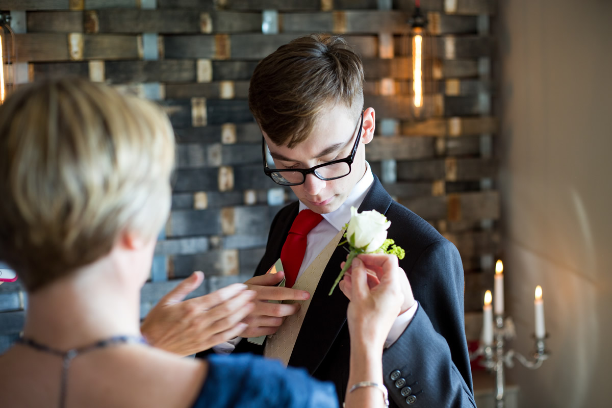 usher having flower attached to lapel at chapel down winery wedding