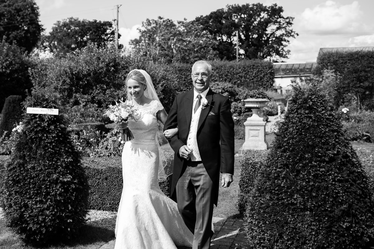 bride walking with father at chapel down winery wedding