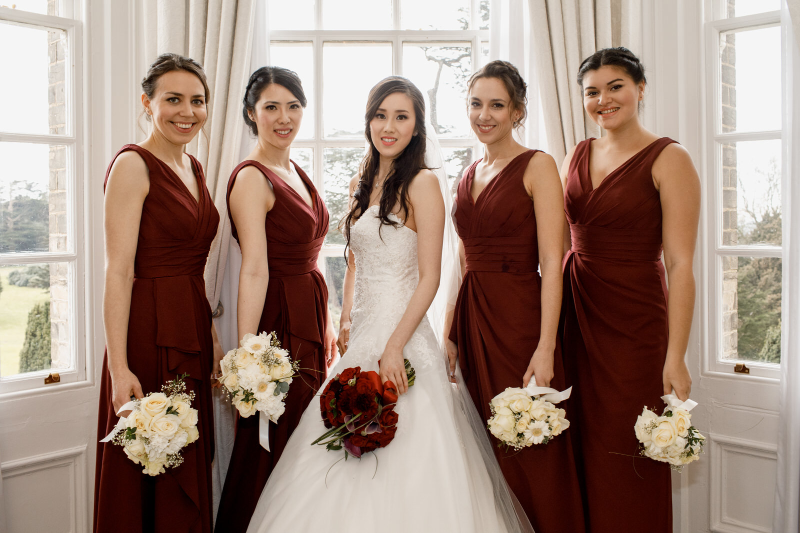bridesmaid and bride at hedsor house bridal suite