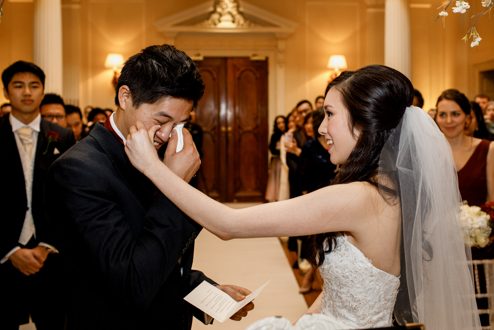 documentary wedding photograpy example of bride wiping tear from grooms eye