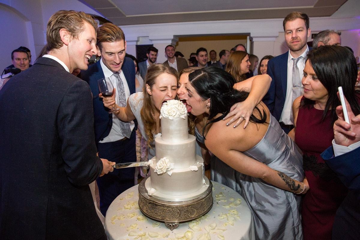 bridesmaids eating cake at wedding day