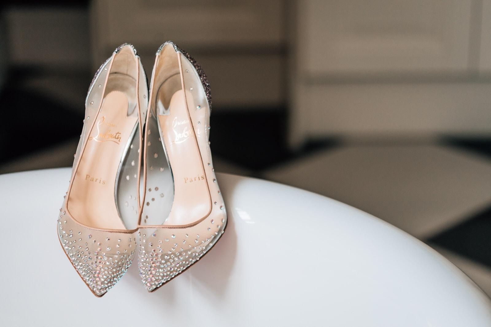 wedding shoes resting on bath