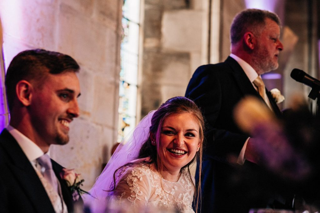 bride laughing at ashdown park wedding