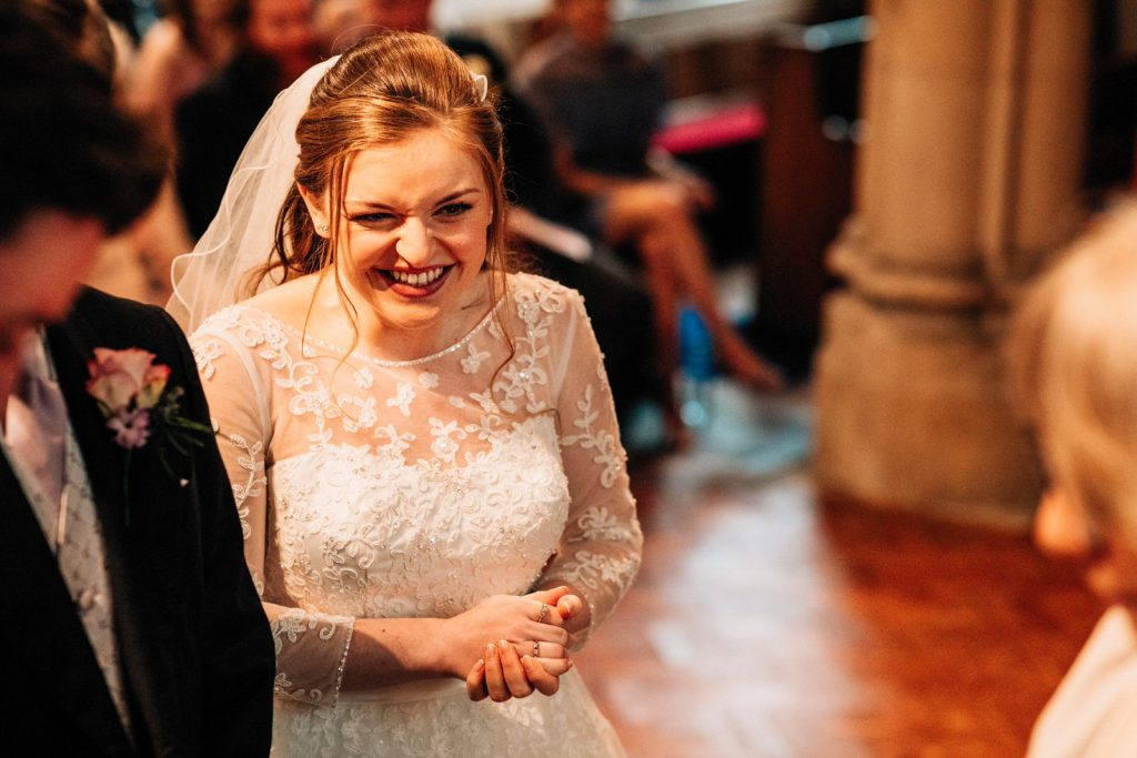 bride laughing in church