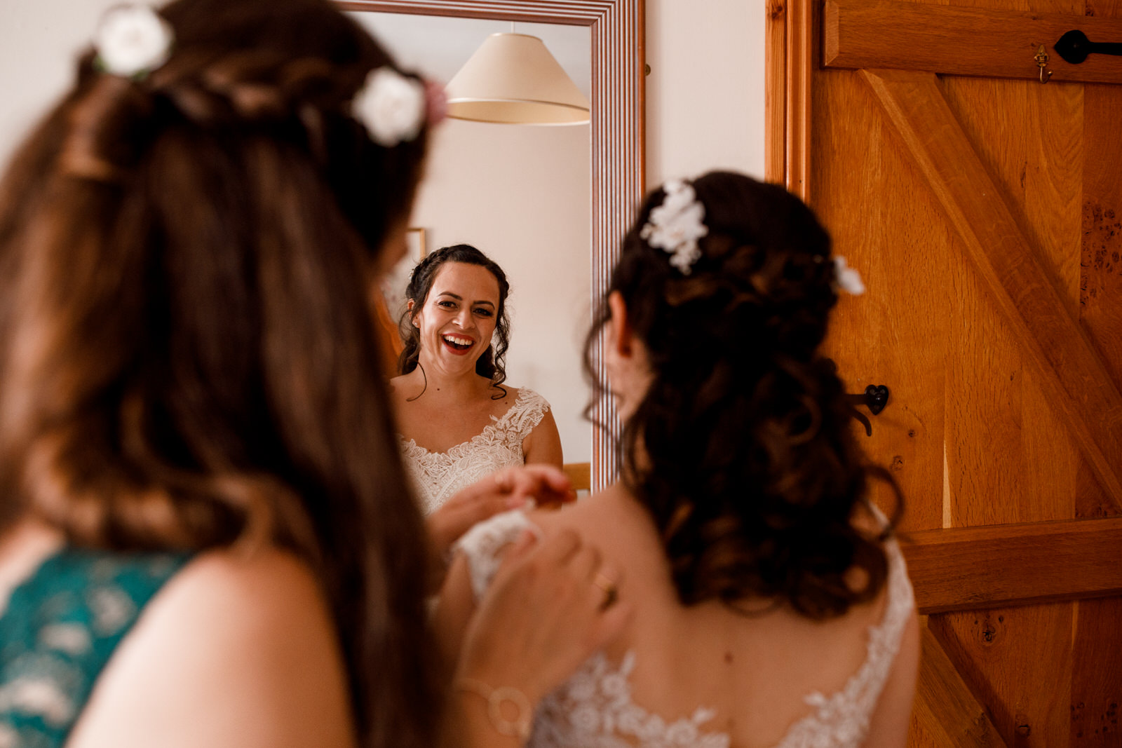 bride and sister getting ready at wedding