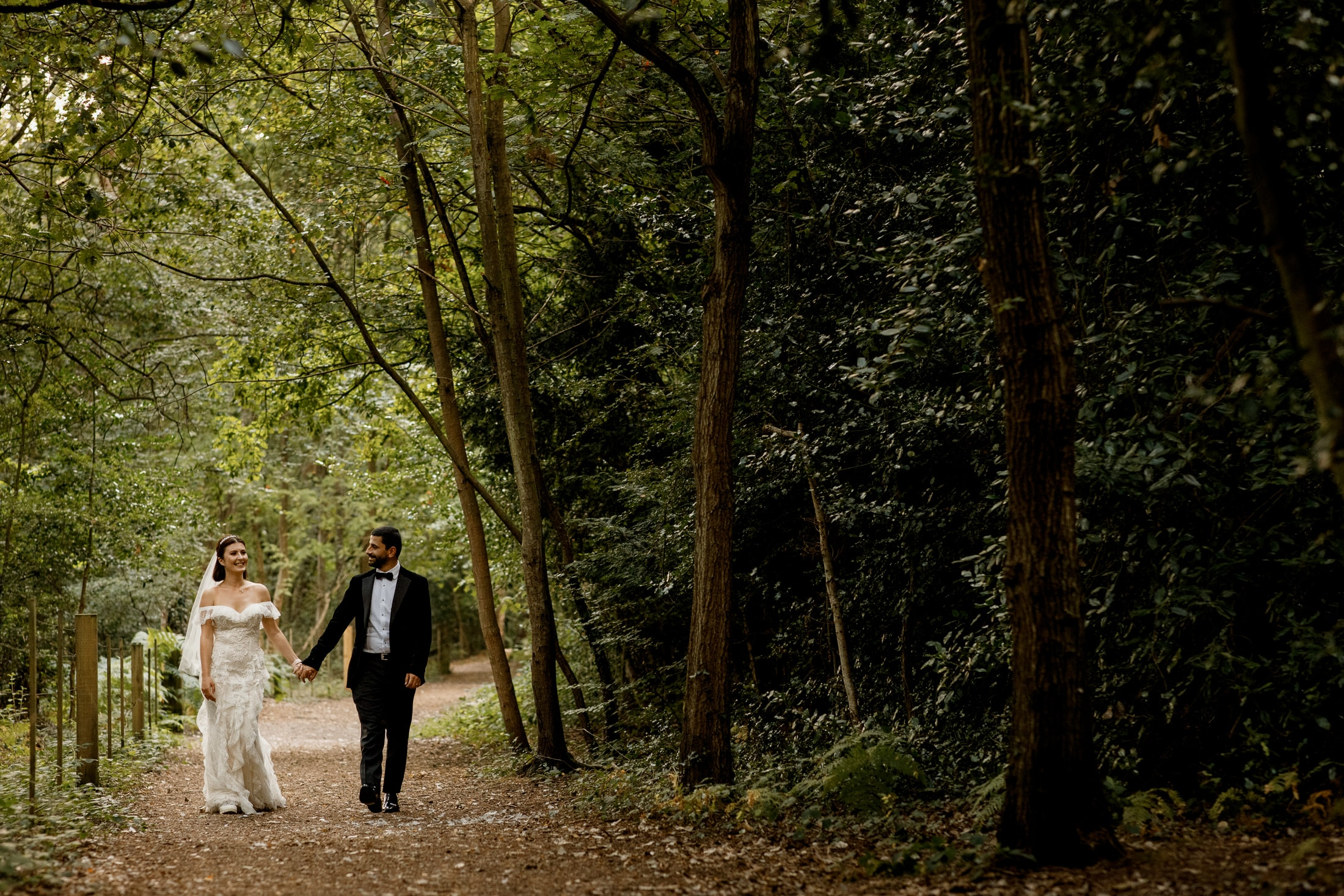 bridal couple walking in burnham beeches