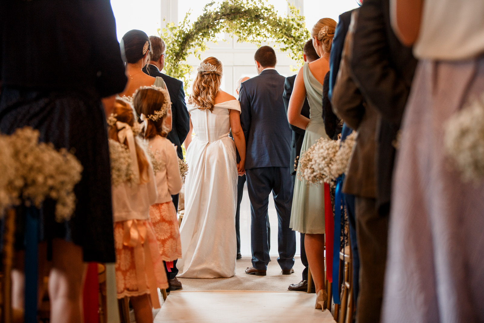 bride and groom at altar of lillibrooke manor wedding