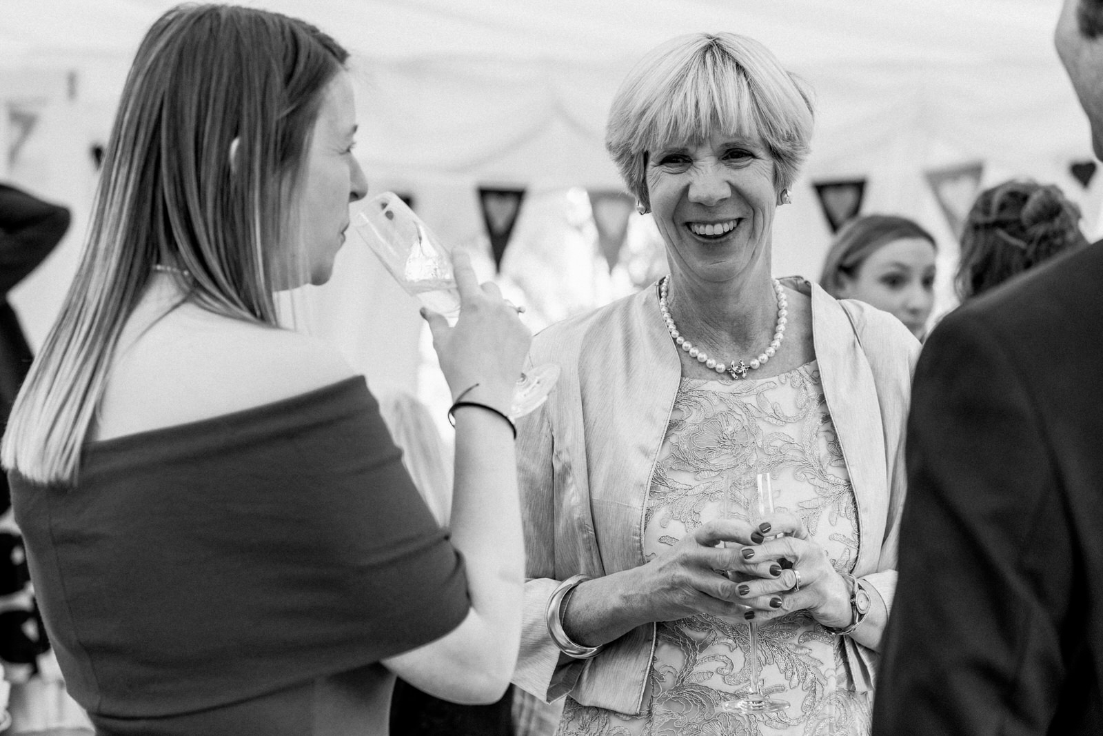 mother of the bride enjoying drinks at micklefield hall wedding