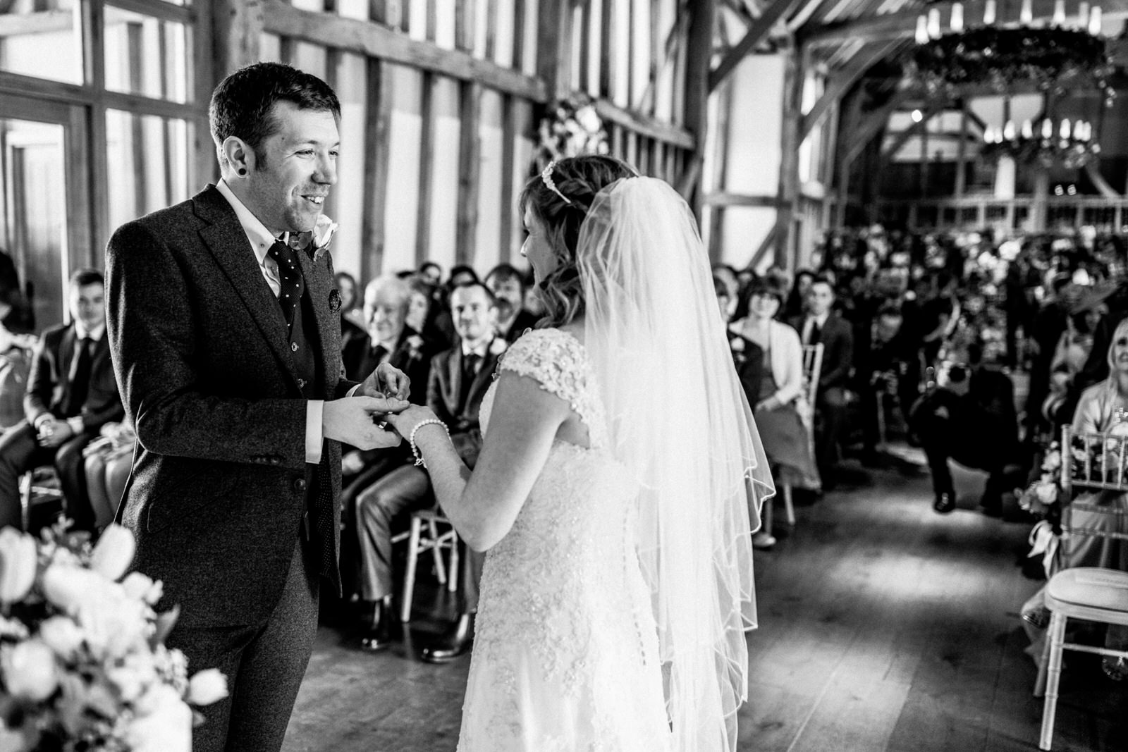 groom putting ring on bride at micklefield hall wedding