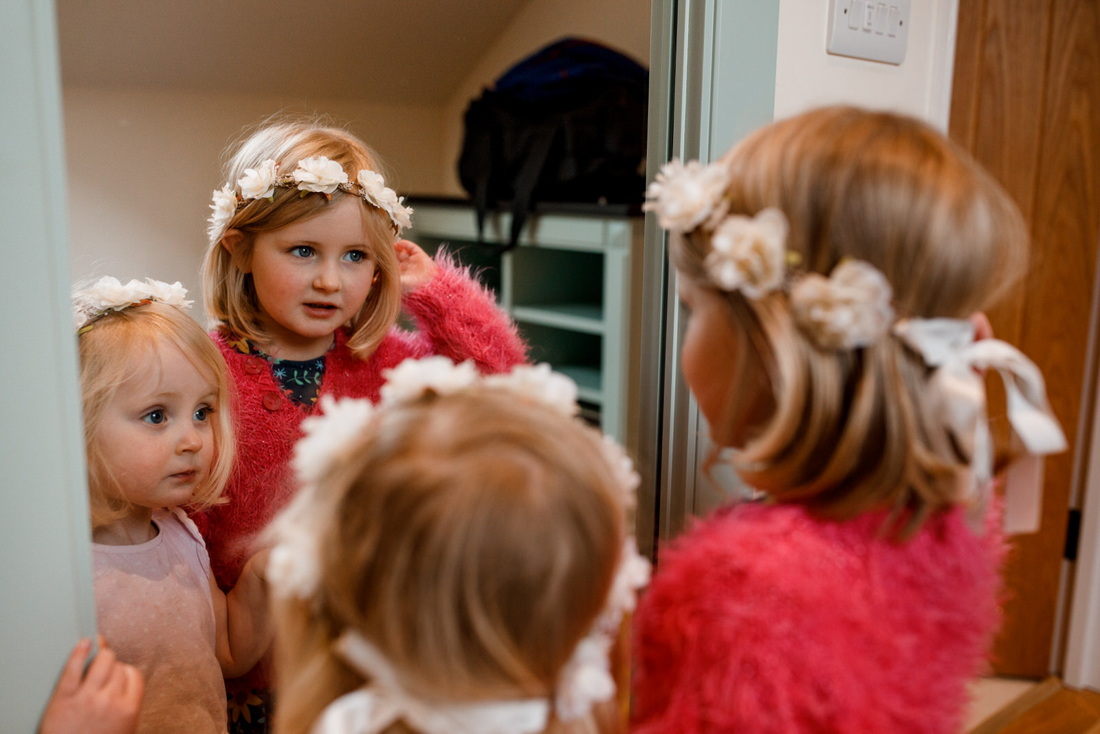 bridesmaid looking at themselves in mirror at micklefield hall wedding