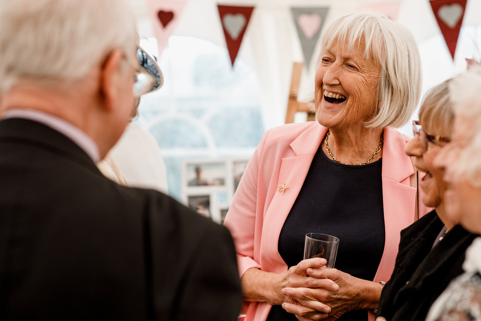 guest laughing at drinks reception in micklefield hall buckinghamshire