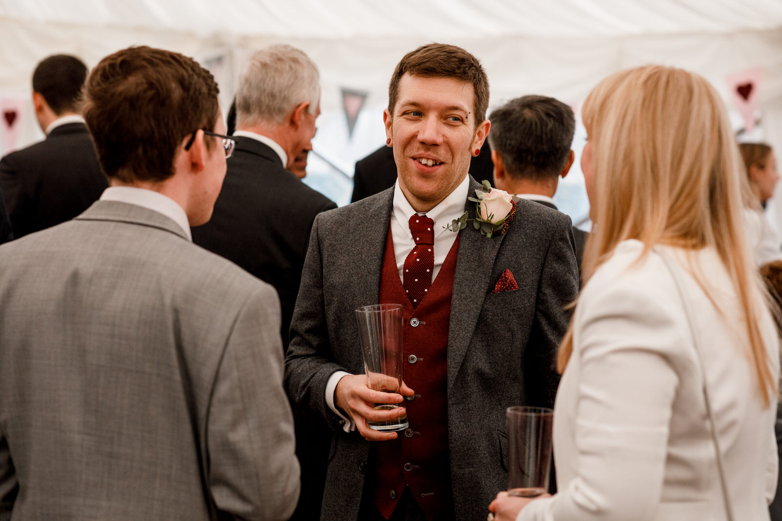 groom in marquee at micklefield hall wedding