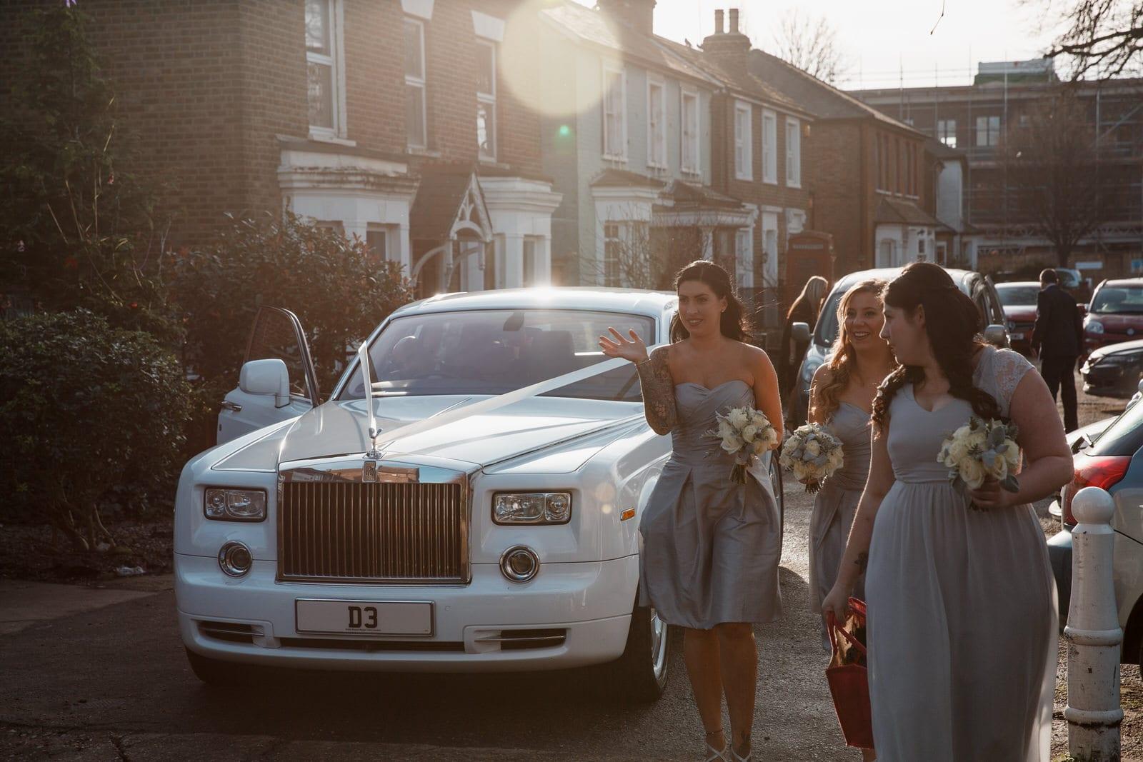 bridesmaid arriving at church for pembroke lodge wedding