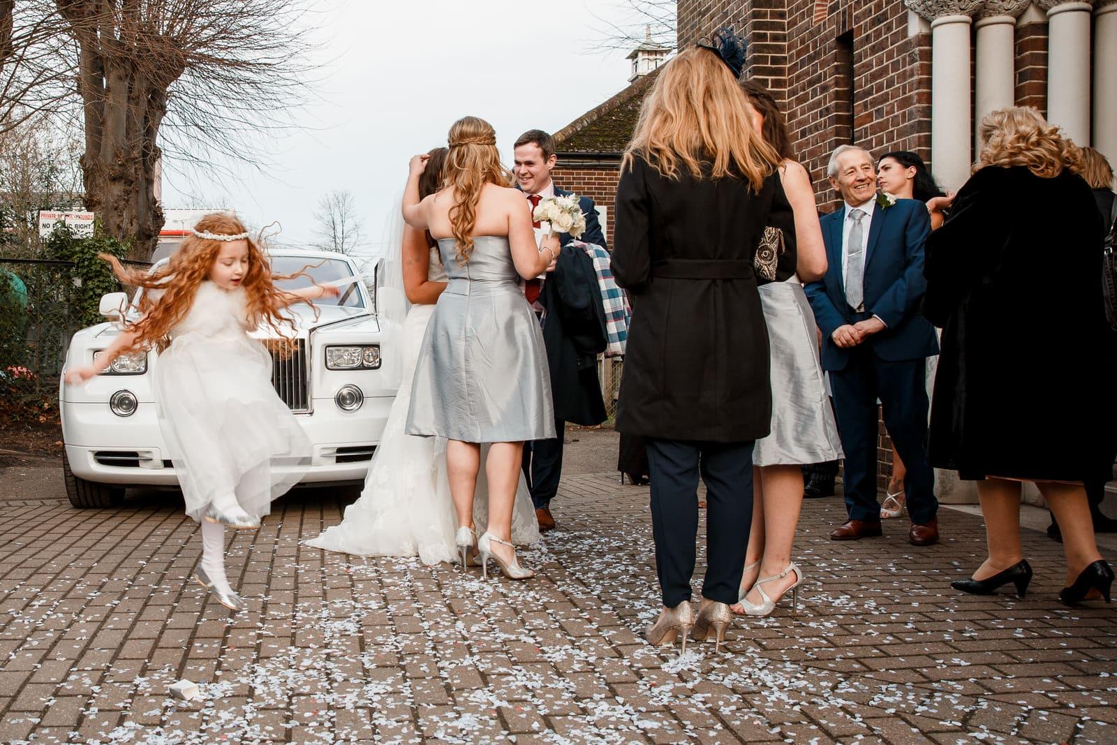 bridesmaid playing outside wedding