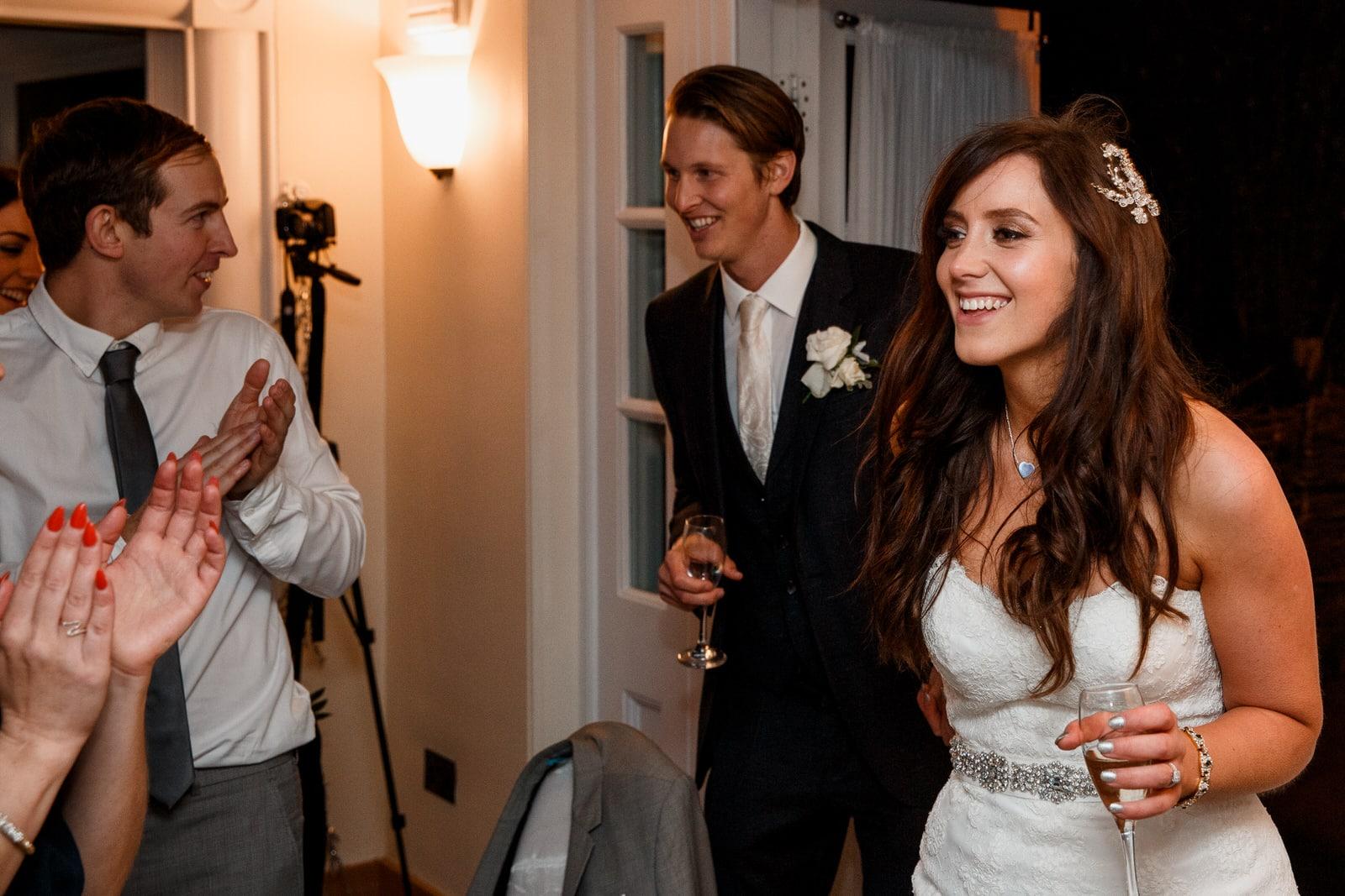 bride and groom entering pembroke lodge for wedding reception