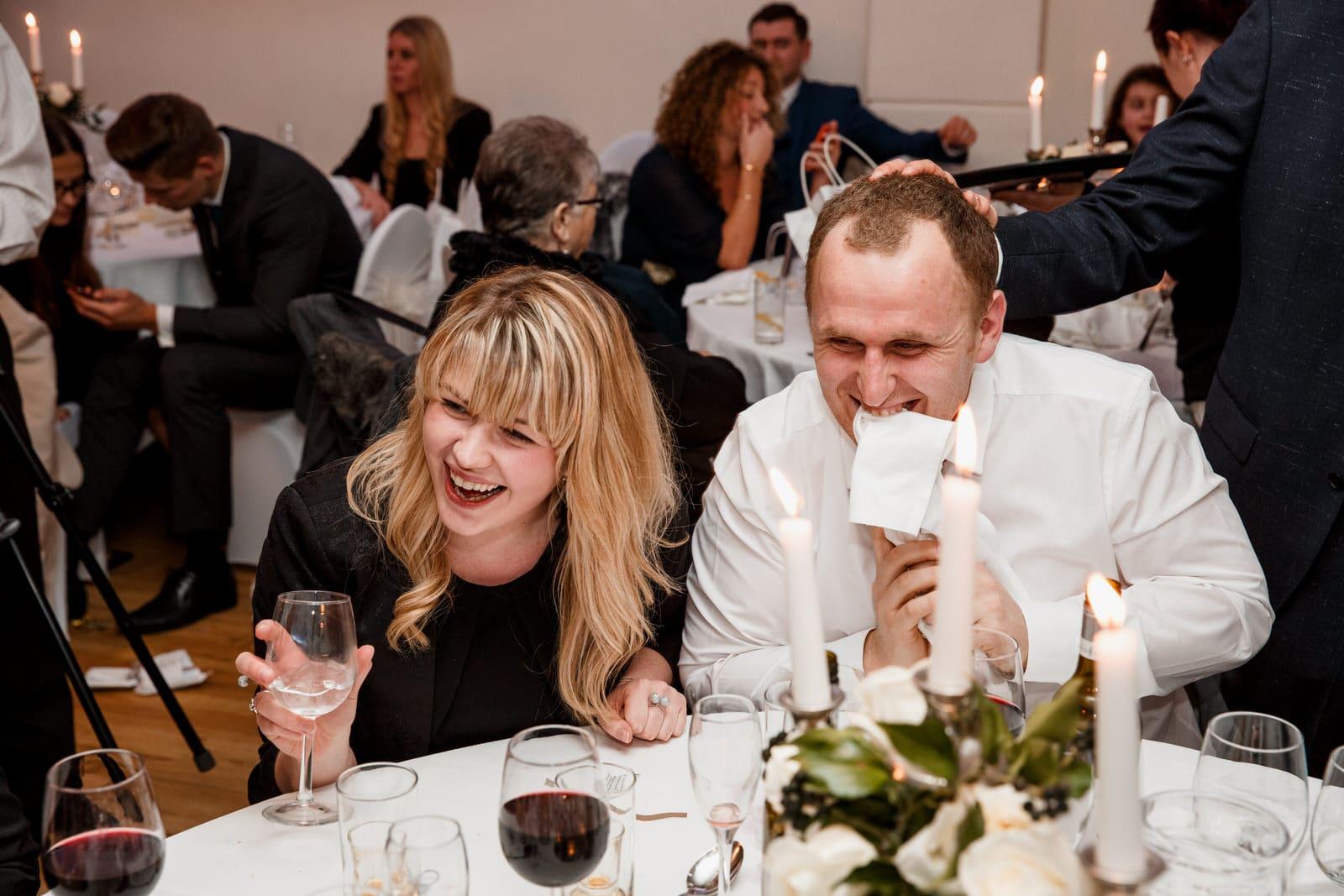 guests joking around at pembroke lodge wedding day