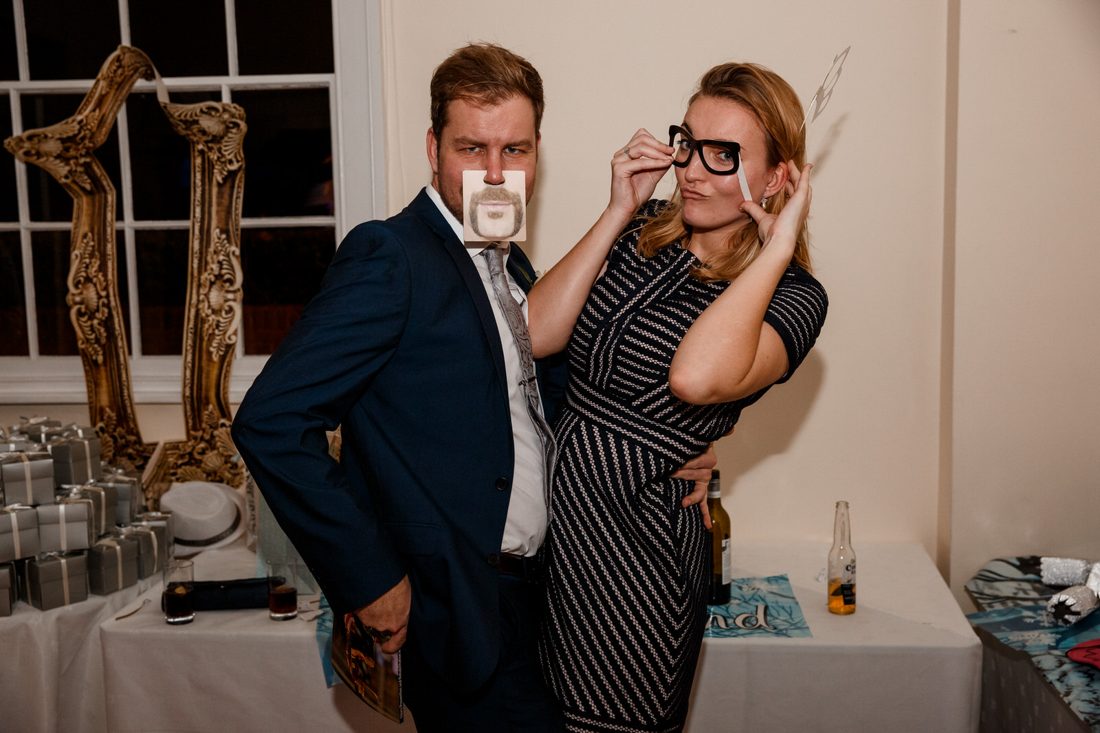 guests with fake moustaches at wedding