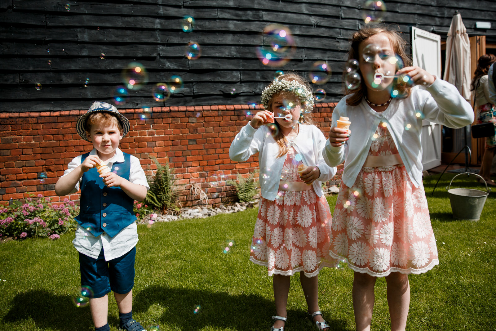 kids playing with bubbles outside lillibrooke manor