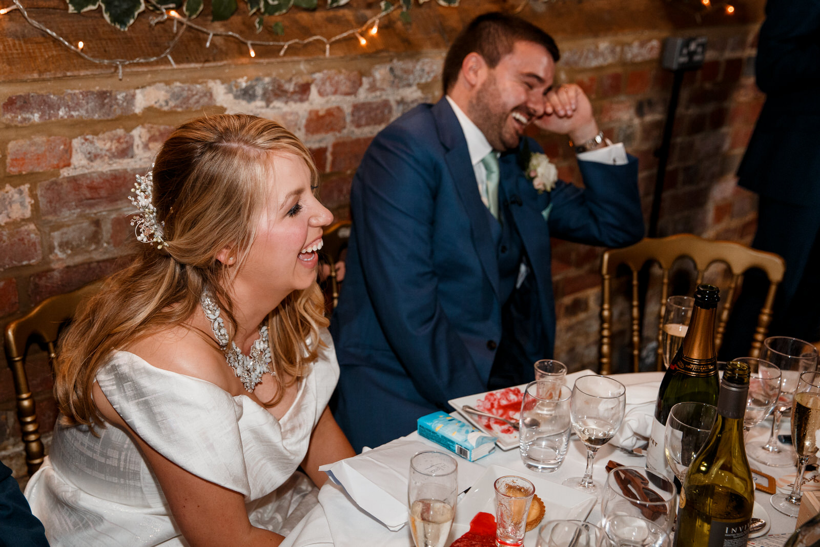 bride and groom laughing at speeches at lillibrooke manor wedding