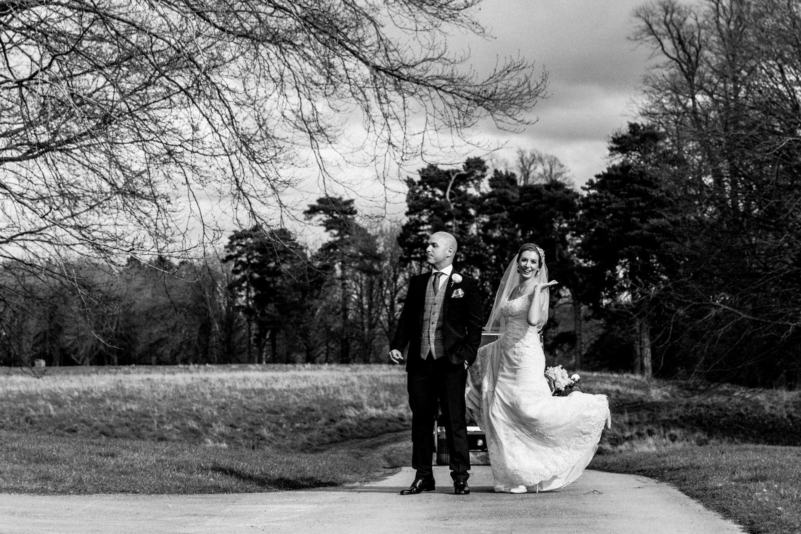 bride and groom in grounds at bowood hotel wedding
