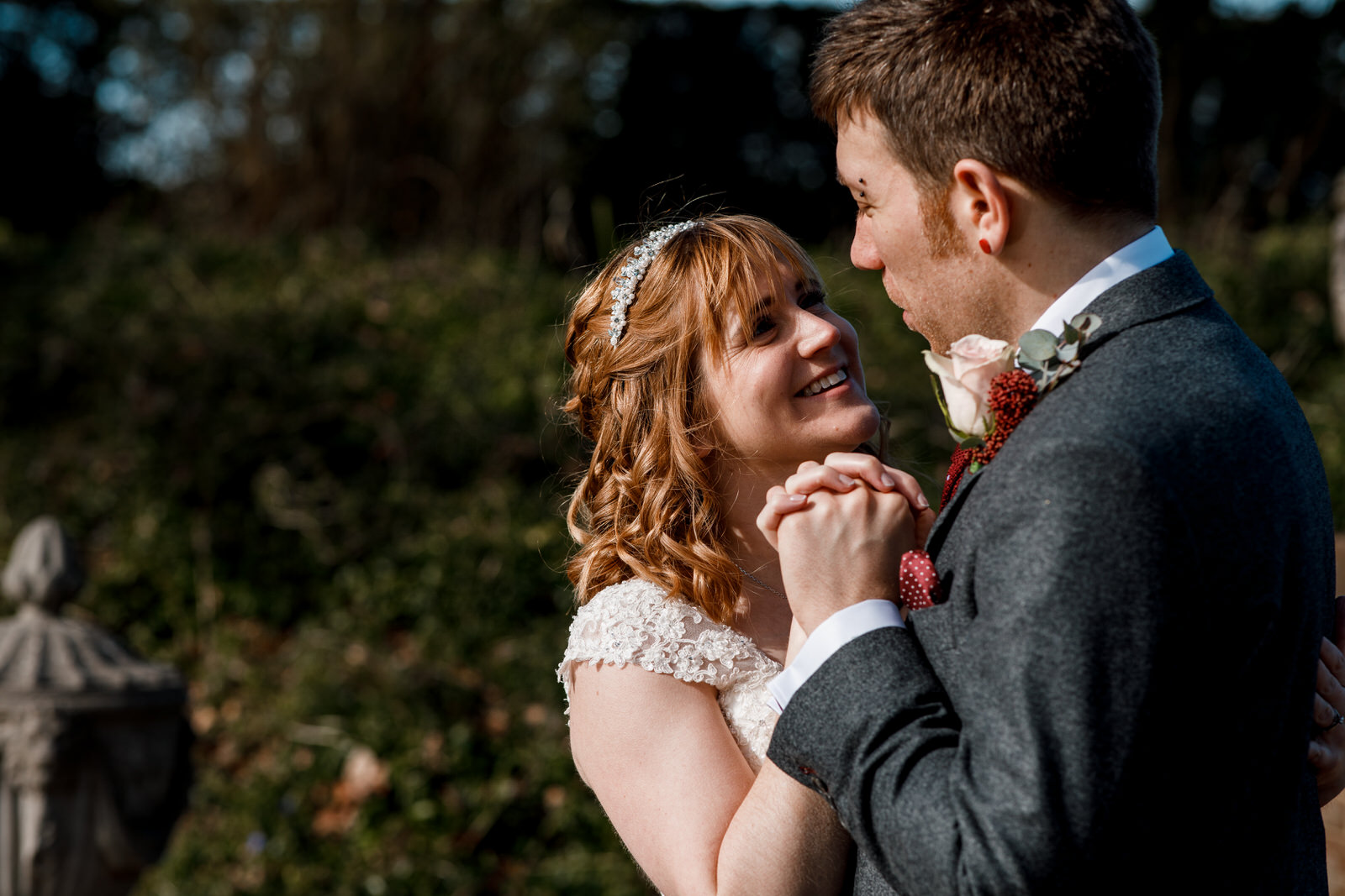 bride and groom in gardens of micklefield hall
