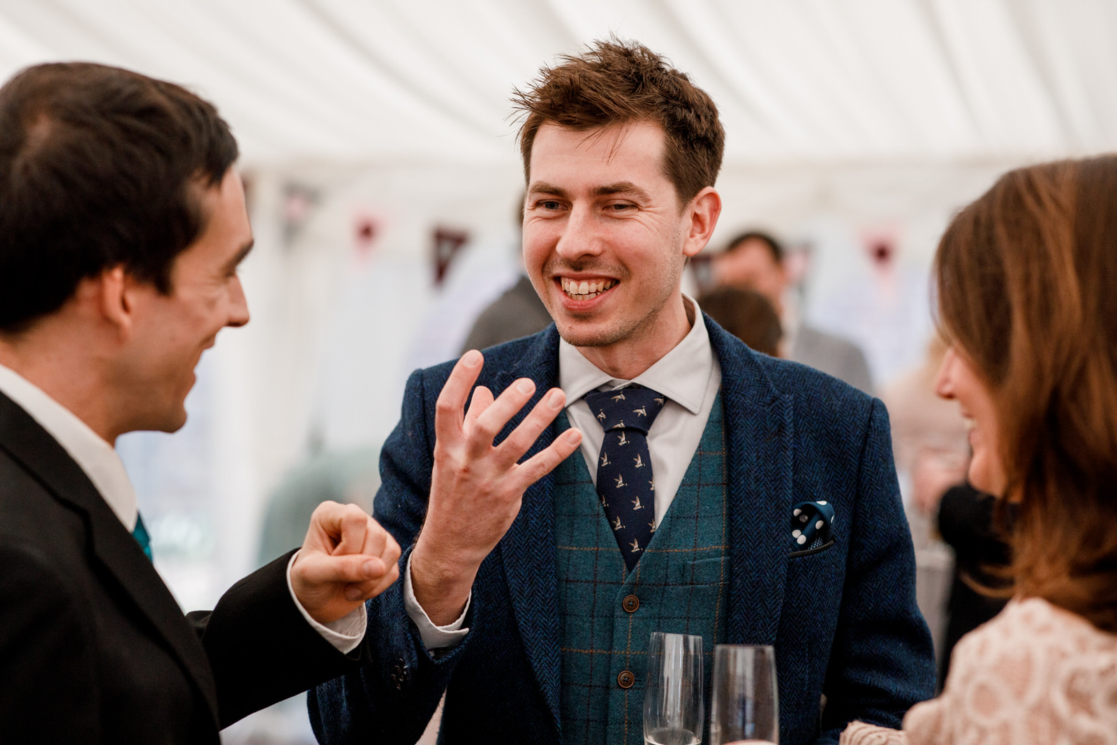 guest laughing at marquee reception