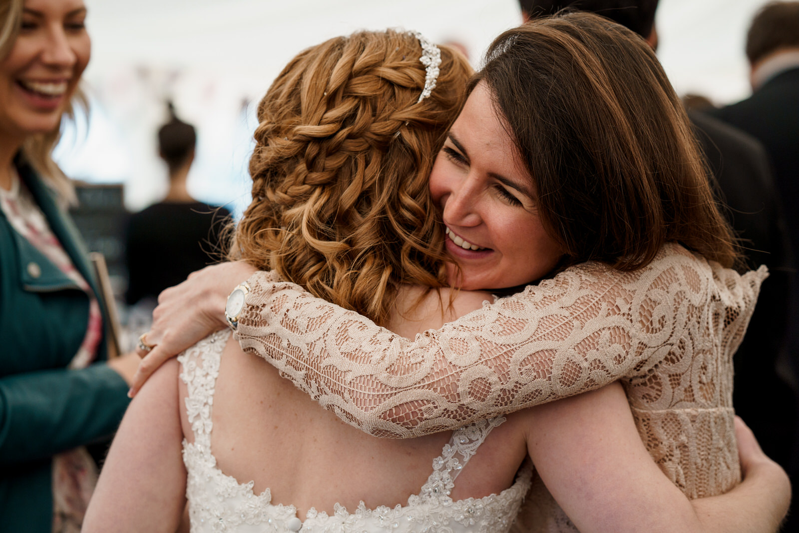 guest hugging a bride
