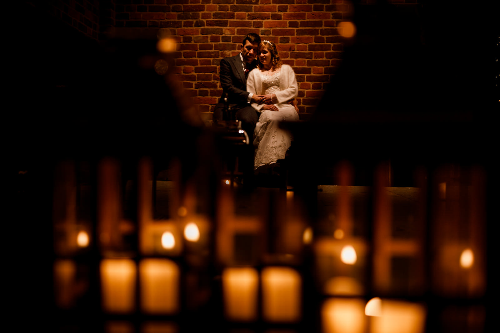 candle lit bride and groom