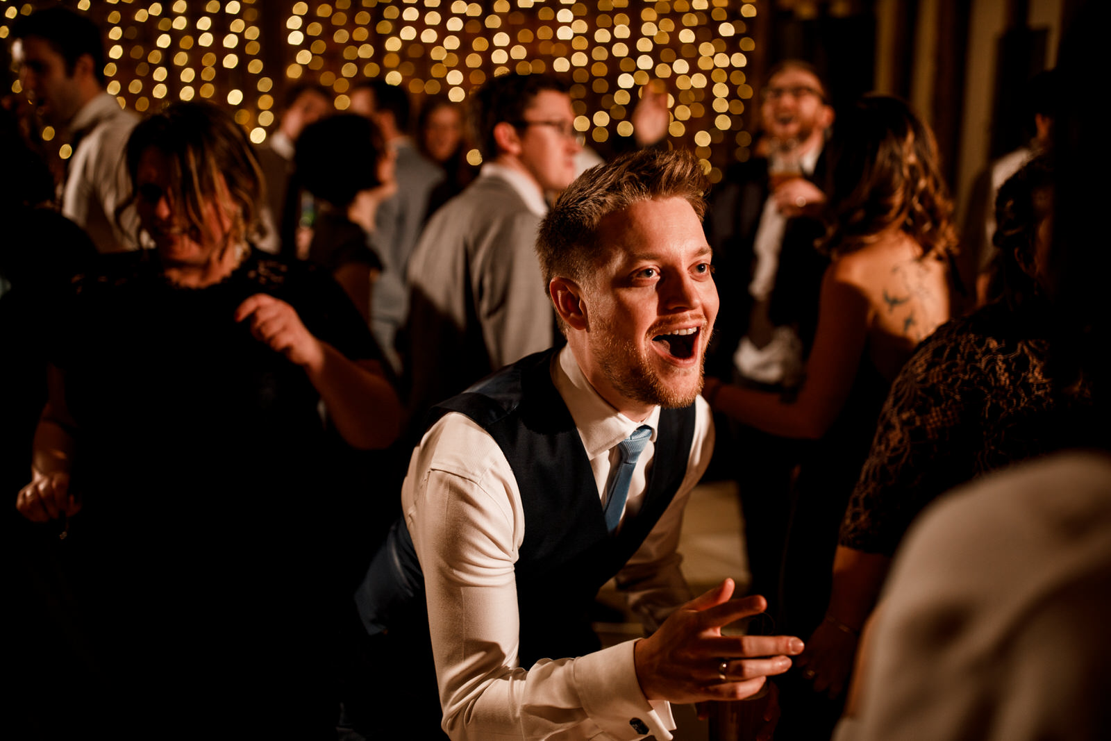 guest laughing on dance floor at micklefield hall wedding