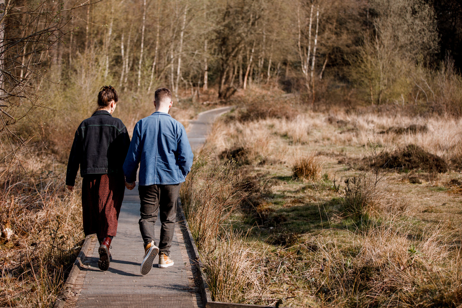 couple walking along path in burnham beeches