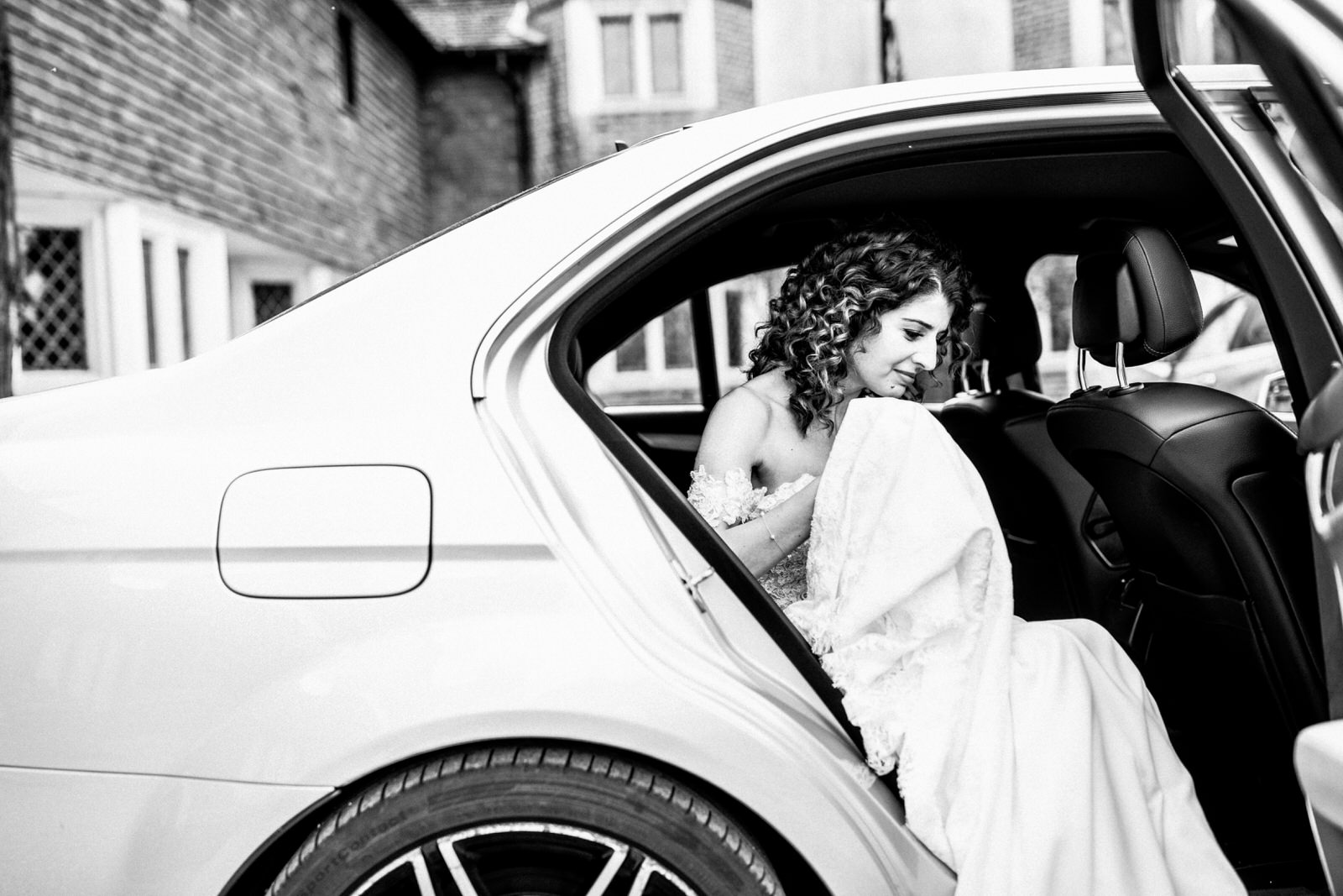 bride arriving at great fosters for wedding