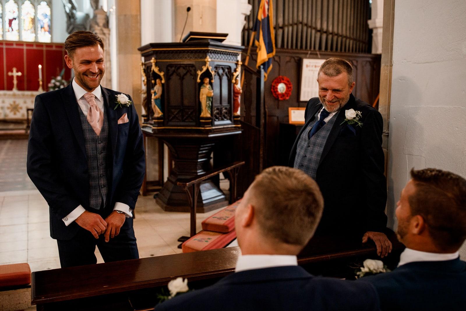 groom in church awaiting bride in old amersham