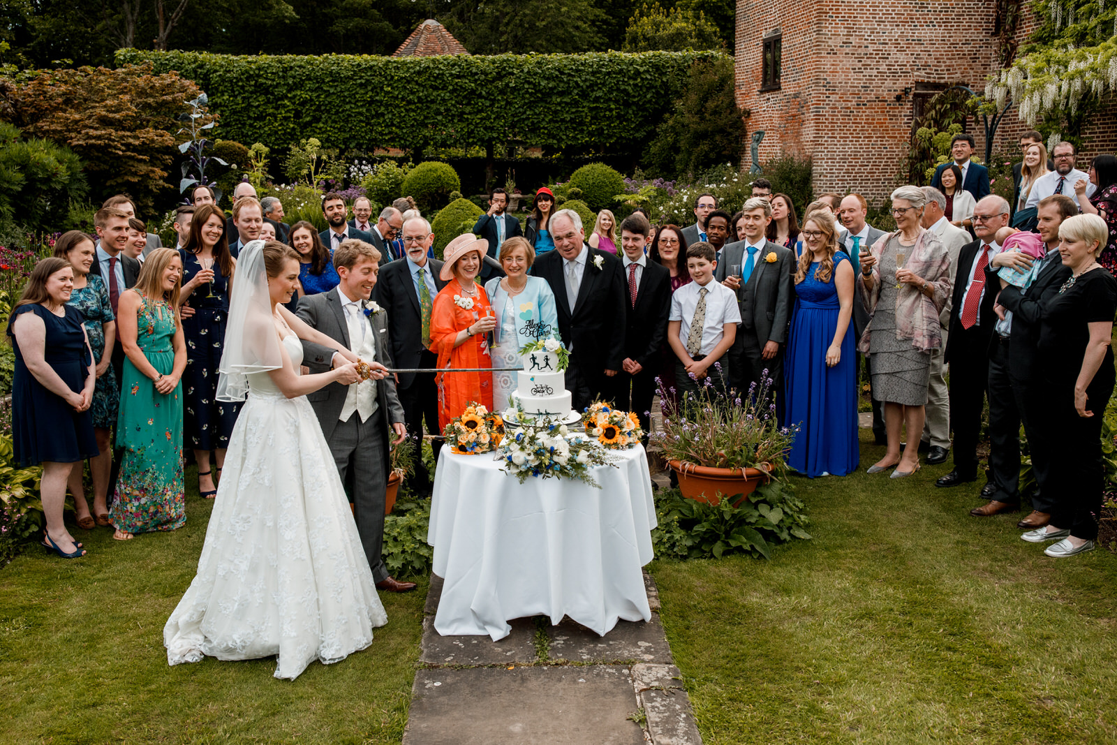 cake cutting at chenies manor house wedding
