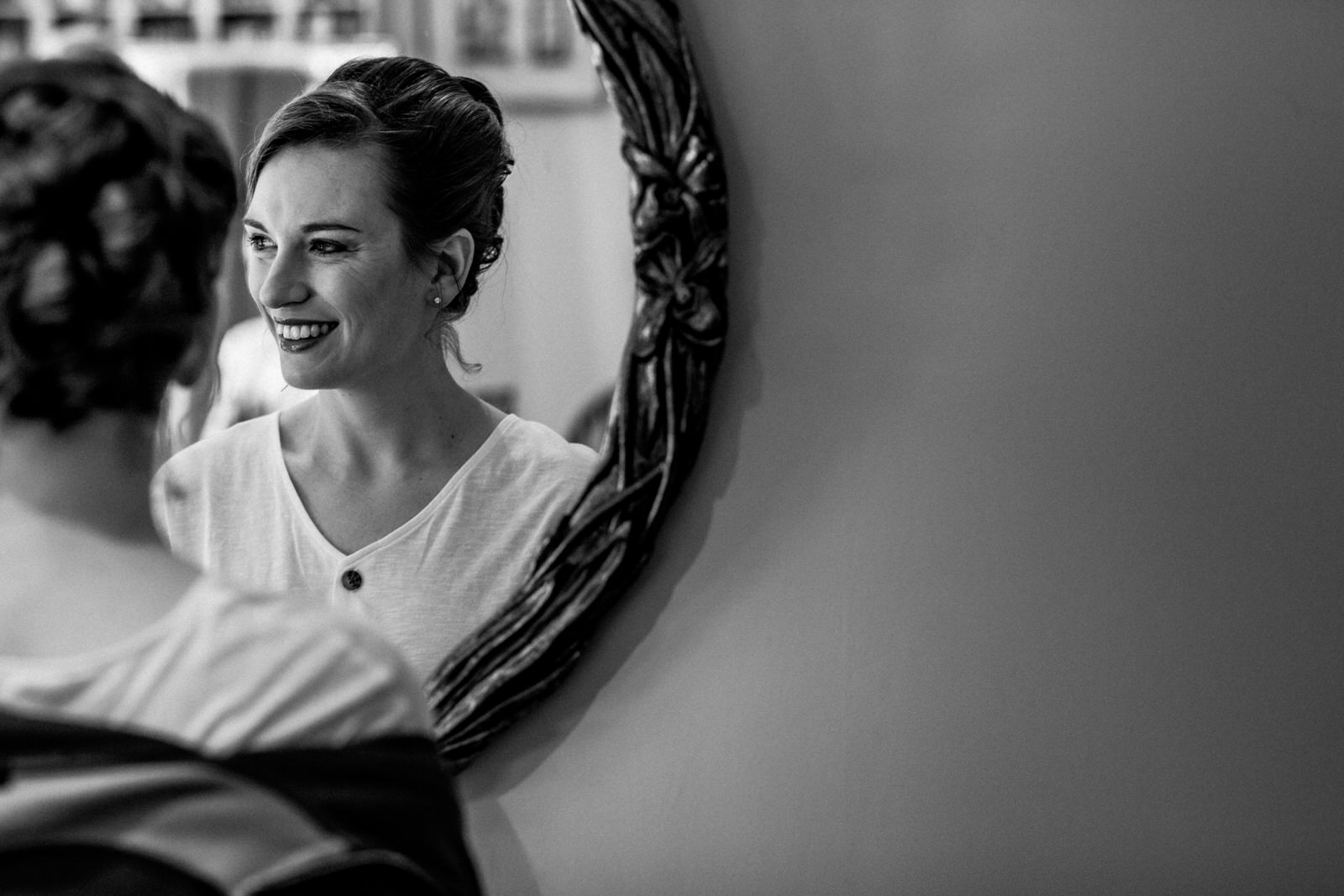 bride getting ready for chenies manor wedding