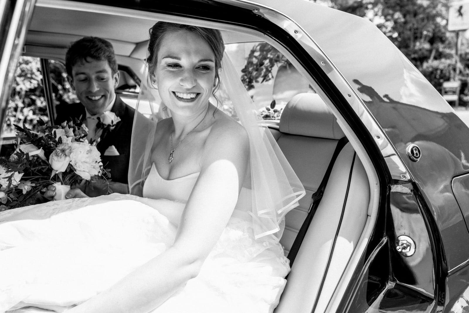 bride in car for amersham wedding