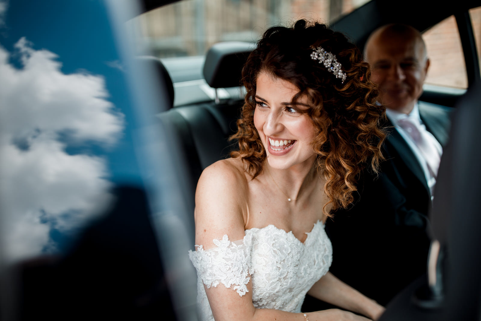 bride arriving in car at great fosters