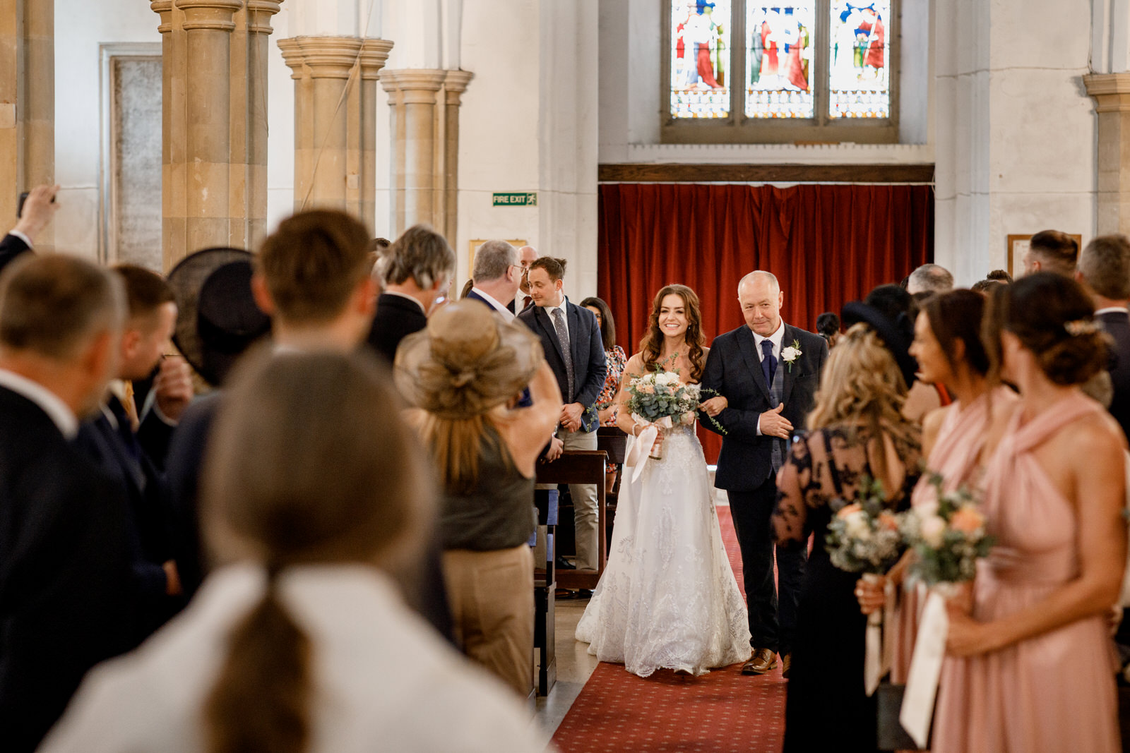 bride walking down aisle in st marys church amersham