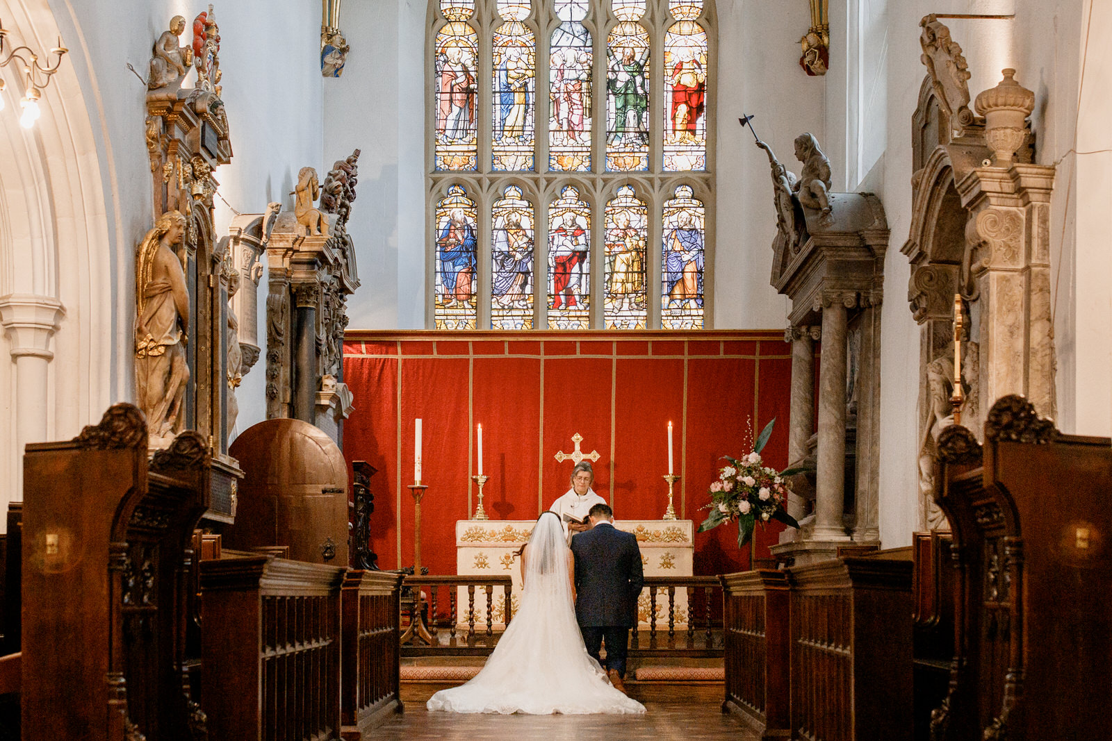 bride and groom kneeling in church