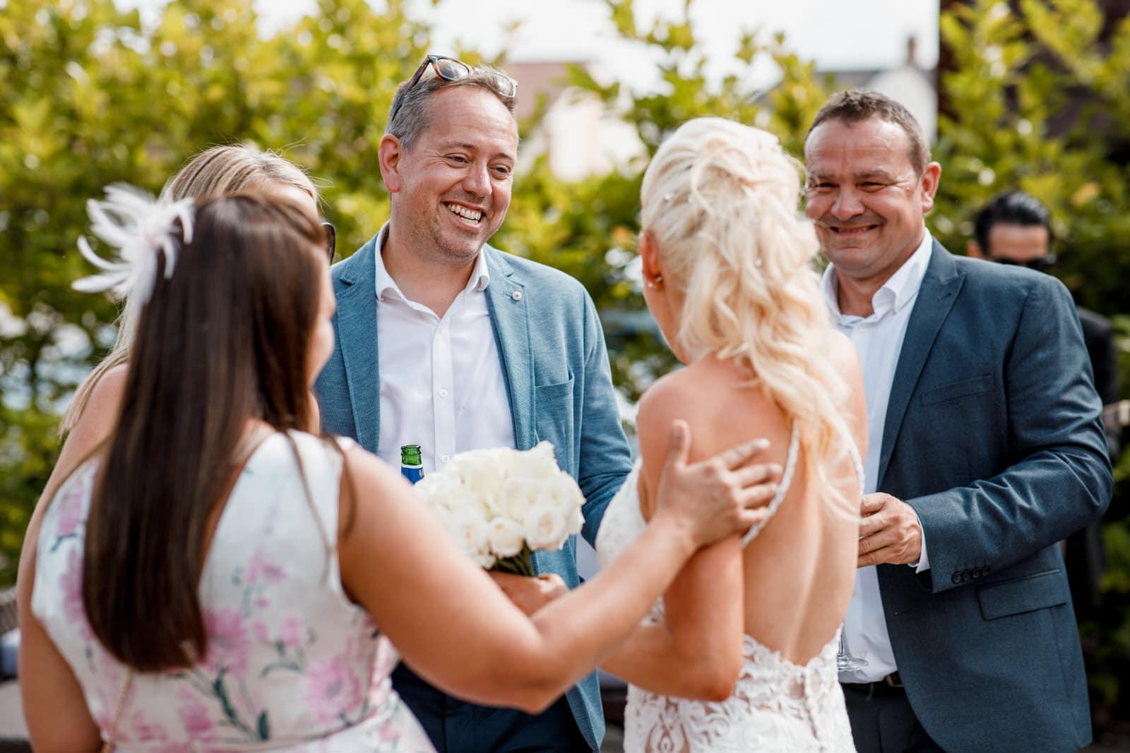 guests enjoying sunshine at wedding