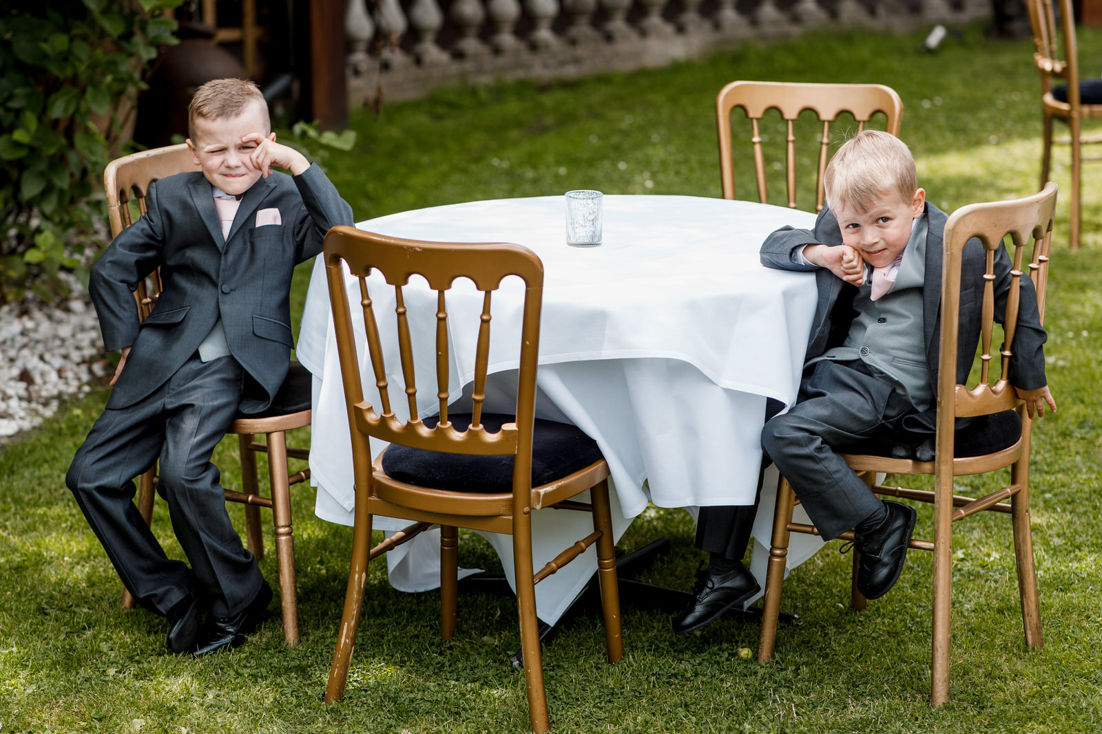 young boys bored at wedding