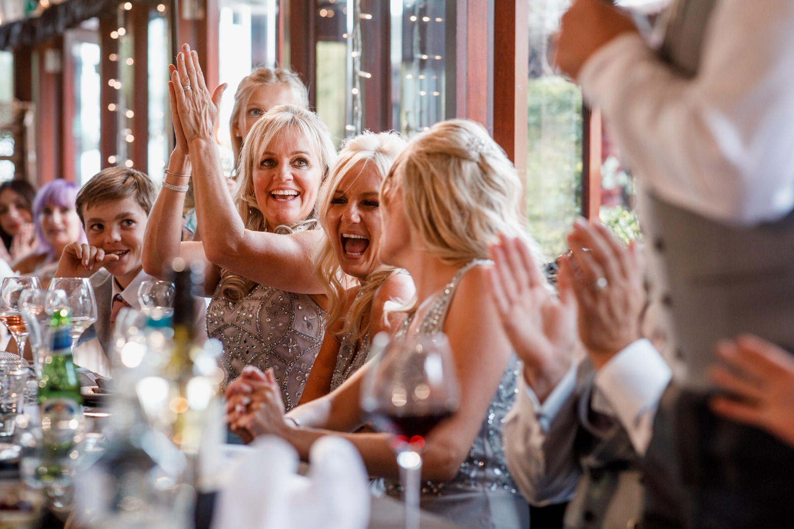 bridesmaids laughing at the wedding speeches